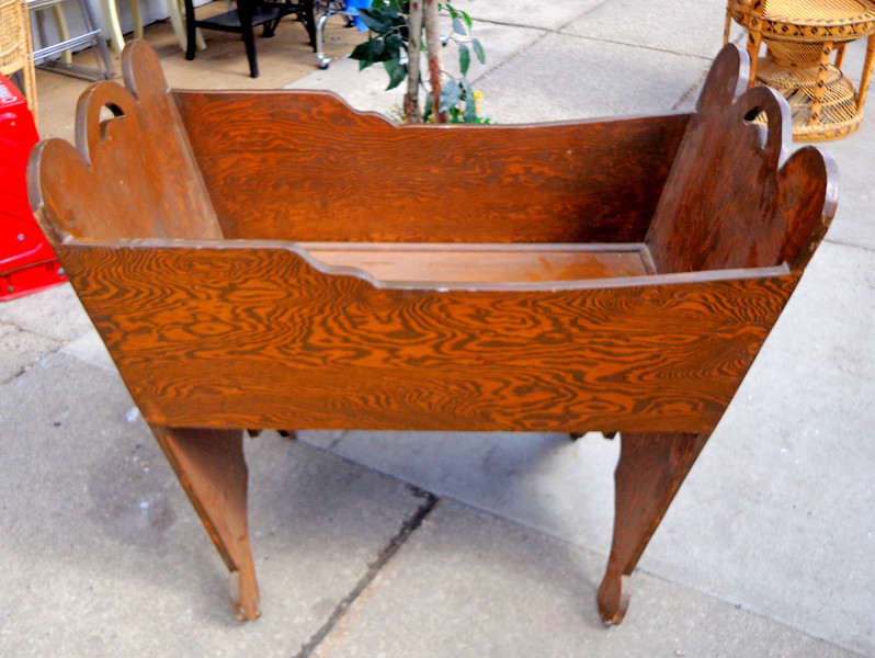 Unique Hard-to-Find Antique Tiger Oak Baby Crib in Excellent Condition.  This remarkable hand-crafted crib is made from tiger oak and harkens back to times gone by.  The piece is in very good antique condition and features wheels on the legs.  42 x 24 x 36.  <b>$350</b>