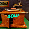 Victor Victrola Phonograph Model VV VI Talking Machine in Good Working Order. The VI was a slight upgrade from the base VV-IV model, offering a 2-spring motor and slightly larger case. Production was started in October of 1911, and discontinued in 1925. Early models, such as this one, were available only available in oak.  These are very rare and are especially difficult to find in such good condition.  13 x 14 1/2 x 14.  <b>$295</b>