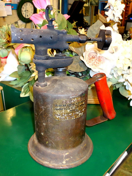 """Antique Clayton & Lambert Manufacturing Company Brass Blow Torch.  This torch measures approximately 11 1/2"""" tall and the base is 5 1/2"""" in diameter. For over 100 years, C&L of Detroit, MI have manufactured a variety of high quality products. There is surface rust on some pieces and the original labels have typical wear from use as pictured.<b>$40</b>"""