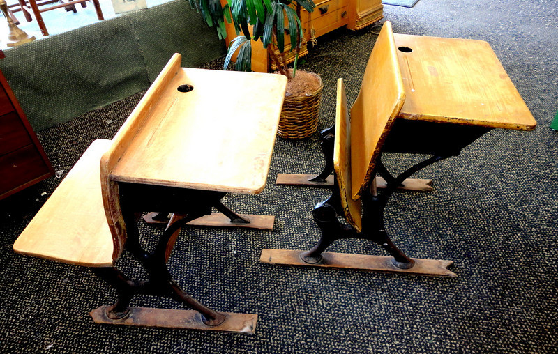 Unique Solid Wood Antique Student Desks.  21 x 29 x 30.  Perfect for home schooling with an historical flair.  The perfect combination of solid wood, metal an antique styling.  Seats fold up as shown.  Only Two Available.  <b>$95 each. </b>