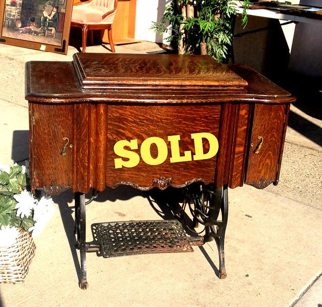 Damascus Antique Treadle Sewing Machine in Quarter Sawn Wood Cabinet.   35 x 19 x 31.  <b> $150</b>