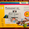 NEW!!!  HP Photosmart 385 Go-Go Photo Printer.  Box was opened, but unit was never removed or used. Everything's included.  <i>Nearly $350 on Amazon.</i>  <b>Our Price: $150</b>