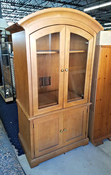 Nice Wood TV Armoire with Glass Doors and 3 Storage Drawers.  Excellent condition.  38 x 25 x 74.  <b>$125</b>