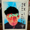 Rare <i>Gary Numan Exile </i> Framed Tour Poster.  <i>Exile</i> is the sixteenth studio album by British musician Gary Numan. Its release continued a critical upswing in Numan's career which began three years earlier with the release of <i>Sacrifice</i>.  Though not a big chart success Exile scored almost universally positive reviews, a contrast to the situation in Numan's early years when he had many hits but was generally condemned by critics.  20 1/2 x 27.  <b>$50</b>