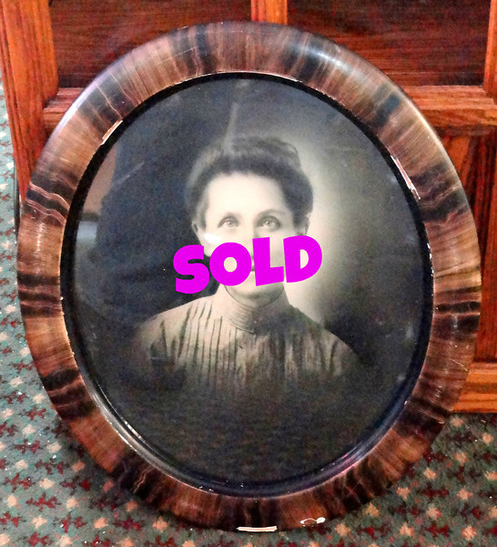 Antique Framed Photo That Will Scare The Crap Out of You.  I think I may have seen this once at the entrance to Disney's Haunted Mansion attraction. Sure, the vintage frame is damaged, but the photo alone is worth the price of admission. We apologize if this is a picture of one of your relatives.<b></b>
