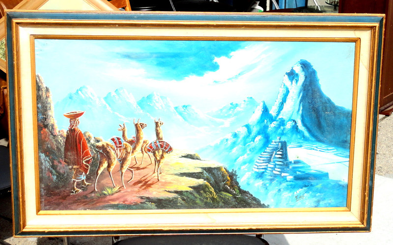 Mountain Sheperd Panorama in Oil.   Peruvian native, traditional alpaca cape, with loaded lamas headed for market day, note the ancient ruins of macho pichccu in the distance.  42 x 26. <b>$40</b>