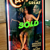 "RARE!!  <i>Carter the Great - The Modern Priestess of Delphi </i>  Framed Poster.  Standing at over 6 1/2 feet tall, this incredible design was one of images that Carter used to promote his final ill-fated tour. Here, an exotic beauty bathes her feet in flame as her crystal ball calls forth the specter of a crone besides her. Midnight blues and mysterious greens set the proper tone for this mystic scene. The role of the ""Modern Priestess"" in the mind-reading act was played by Evelyn Maxwell, Carter's chief assistant.  Artist imagery includes a witch-like apparition, bats, Sphinx and Great Pyramids of Egypt. Caption reads ""The Modern Priestess Of Delphi / Your Mind Is An Open Book To Her"". The Otis Lithograph Co. Cleveland, O. Circa 1926. Three-sheet.  44 x 80.  <b>$1,295</b>"