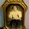 Antique Girl on Tricycle in Ornate Glass Covered Frame.  13 x 20.  <b>$75</b>