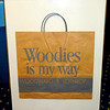 1920's Woodward & Lothrop 'Woodies Is My Way' Department Store Bag in Frame.  For many longtime Washington residents, the Woodward & Lothrop department store, or Woodies as everybody knew it, is a touchstone for memories of easier days and simpler pleasures when Washington was younger. The looming 9-story building at 11th and F Streets, NW, taking up virtually an entire block in the heart of old downtown, served as the stage for many happy moments and a reminder that shopping has long been a key form of entertainment.  22 x 28.  <b>$65</b>