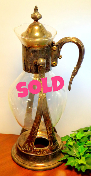 Antique Glass Coffee Carafe with Silver Plated Warmer Stand.  7 x 15.  <b>$40</b>