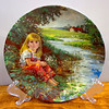 "A Quiet Moment By Stewart Sherwood Collector's Plate.  Second plate in the Reflections of Canadian Childhood collection from Dominion China, Ltd., a series of limited editions honoring Canada's most precious resource, her children. ""A Quiet Moment"" is an original work of art created by renowned Canadian artist Stewart Sherwood. Availability of ""A Quiet Moment"" will be strictly limited by confining its manufacture to a period not to exceed 150 firing days.  <b>$25</b>"