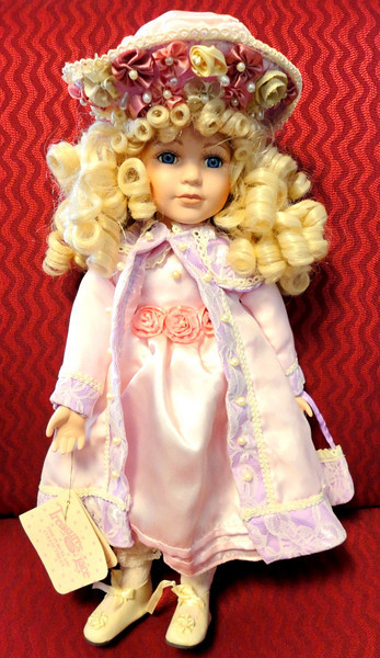 Like New Treasures in Lace 18-Inch Porcelain Doll.  <b>$35</b>