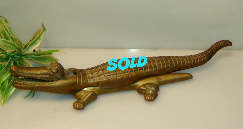 Vintage 2-Piece Brass Alligator Nut Cracker.  Excellent condition.  On the heavy side.  A well-made fun piece. Crocodile nut cracker.  15 x 4 x 3.  <b>$45</b>