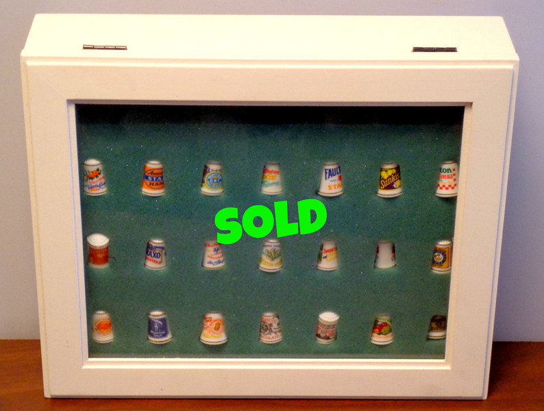 Unique Set of 21 Sewing Thimbles with Array of Vintage Company Logos.  Branding includes Lipton Tea, Hersheys Chocolate, Heinz Sweet Pickles, Sunkist among others.  12 x 3 x 10. <b>$20</b>
