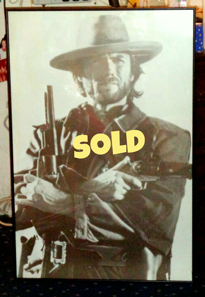 Classic Clint Eastwood Poster From Fist Full of Dollars in Frame.   Fist Full of Dollars is a 1964 spaghetti western film directed by Sergio Leone and starring Clint Eastwood.  Released in Italy in 1964 and then in the United States in 1967, it initiated the popularity of the spaghetti western film genre.  Long before punks made his day as Dirty Harry, Clint was blasting away in the Wild West and not saying much then either.  24 x 36.  <b>$40</b>.