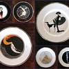 Rare Set of 6 <i>Mikasa Erte</i> Fine Bone China Collector Dinner Plates in Excellent Condition.  Plates include clockwise from upper left <i>Flames D Amoire, Ondee, Symphony in Black, Alphabet D,  Statue of Liberty, and L'Amour.</i>  All Plates measure 12 1/2 inches and are in excellent condition.  Visit the Collectibles Section of our website for more details about each of these highly sought after plates.