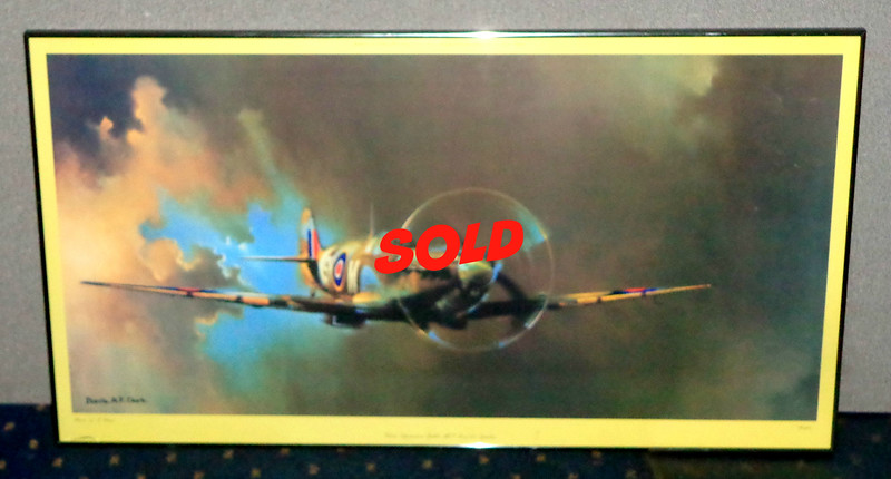 """<i>Vickers Supermarine Spitfire</i> Large Color Lithograph by Barrie A. F. Clark.  A Super marine Spitfire is a ferocious predator, depicted with a whipsaw propeller and a dramatic shroud of fire-scorched smoke. An iconic symbol of victory against overwhelming odds, the legendary fighter plane was flown by England's RAF in World War II's Battle of Britain. That battle marked the first defeat of Hitler's military forces, and was the first major battle in the world fought entirely in the air.""""  42 x 23.  <b>$125</b>"""