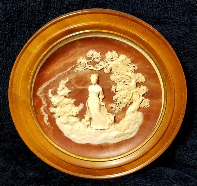 <i>Bradex - She Walks in Beauty</i>  Unique vintage solid incolay stone carved plate with beautiful relief image. This one is plate number 34374. It's called She Walks in Beauty John Keats and sculpture is by Gayle Bright Appleby. This is the second in the series of limited edition plates from the Romantic Poets that was closed in 1978. Made by the Incolay Studios in California.  It's about 10 1/4 inches wide and in mint shape with no cracks or chips. Heavy plate.  In wood frame.  <b>$40</b>