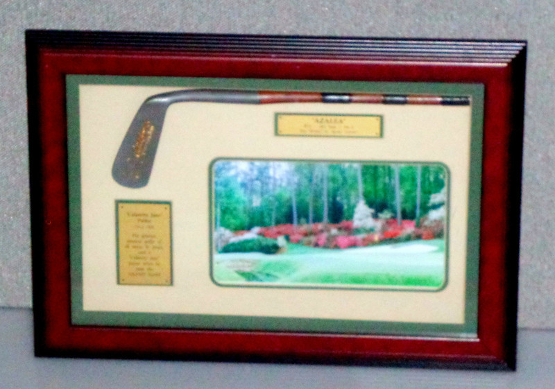 """""""Calamity Jane"""" C. 1926 Putter And Photograph.  Mounted in a shadowbox honoring B. Jones one of the greatest amatuer golfers who used a putter when he won the Grand Slam in 1930; along with a photo """"Azalea"""" of the par 5, 13th hole, """"Amen!"""" to """"Amen Corner"""".  8 x 30.  <b></b>"""