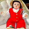 Adorable Life-Like Doll In Red Jump Suit.  <b>$45</b>