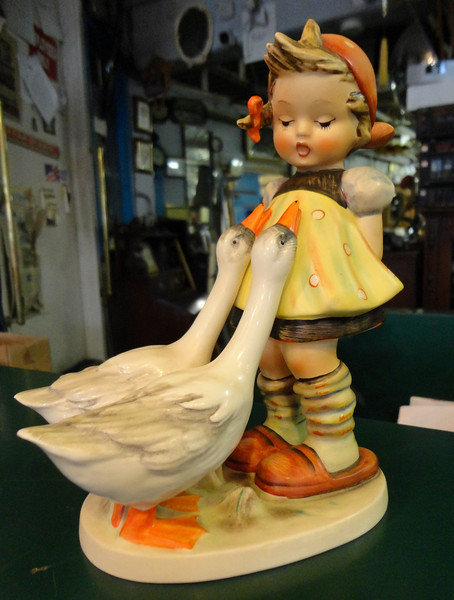 Extremely Rare Hummel Goose Girl Figurine #47/2.  Excellent collector's condition.  This is just one of many authentic M.I. Hummel figurines currently available at our store.  Now is a great time to stop by and see these beautiful pieces.  Our entire collection is priced way below comparable prices advertised nationally.  This is truly a Hummel Collector's dream. 7 x 4 x 8. <i>Goose Girl: $700 New, Sold Used Nationally for $400.</i>  <b> Our Price: $195</b>