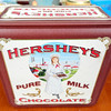 Hershey Pure Milk Chocolate Collector's Tins.   Just wait till you see the nice assortment of Hershey Chocolate collector's tins and other Hershey collectibles that just arrived at our Warren store.  If you or someone you know is a collector, then please suggest that they stop by the store and check out these great condition items.  Take a look at the Collectibles Section of our website for a sampling. <b>$15</b>