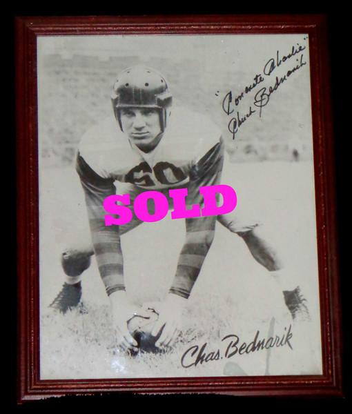 Framed Philadelphia Eagles Hall of Famer Chuck Bednarik Autographed Photograph.  18 x 22.  <b>$65</b>