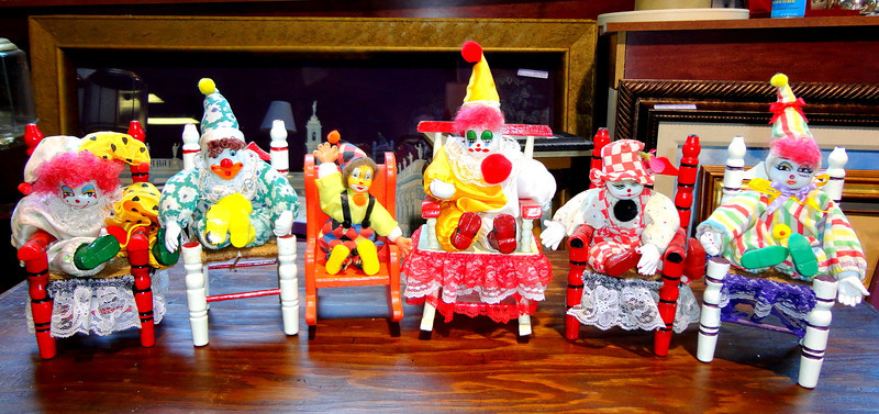 Fred's Unique Insane Clown Posse Collection.  No, these aren't related to the rock group in any way, but this certainly is a great collection of festive clowns seated in chairs.   Most measure appx. 5 x 4 x 7.