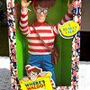 """Mattel Where's Waldo? Talking Waldo Doll.  Retired Collectible Doll Dated  1991.  A collector's classic.    <i><b>This item is NEW in-the-box.</i></b>  Product Features:   Where's Waldo 18"""" Talking Doll.   Approx 18"""" Tall.  Includes 2 Talking Discs, Waldo will say 20 different things he wants you to find.  Doll Size Carry Pouch for discs, Requires 1  AA Battery (not included), for Ages 3 & up.   <b>$65</b>"""