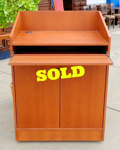 Basic Presenters Podium.   Features plenty of storage cabinet space and keyboard tray.  32 x 26 x 45 1/2.  <b>$195</b>