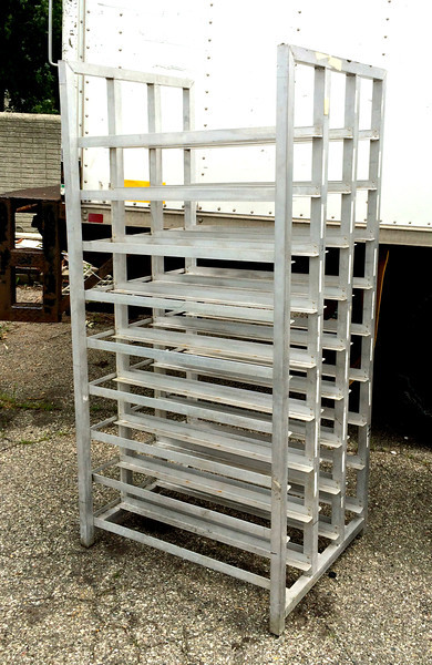 Commercial Grade Front Load Aluminum Bun Pan Oven Rack   Each unit features 27 racks measuring 7 x 36 each.  Overall Dimensions:  29 x 36 x 73.  Two available.  <b>$125 each. </b>