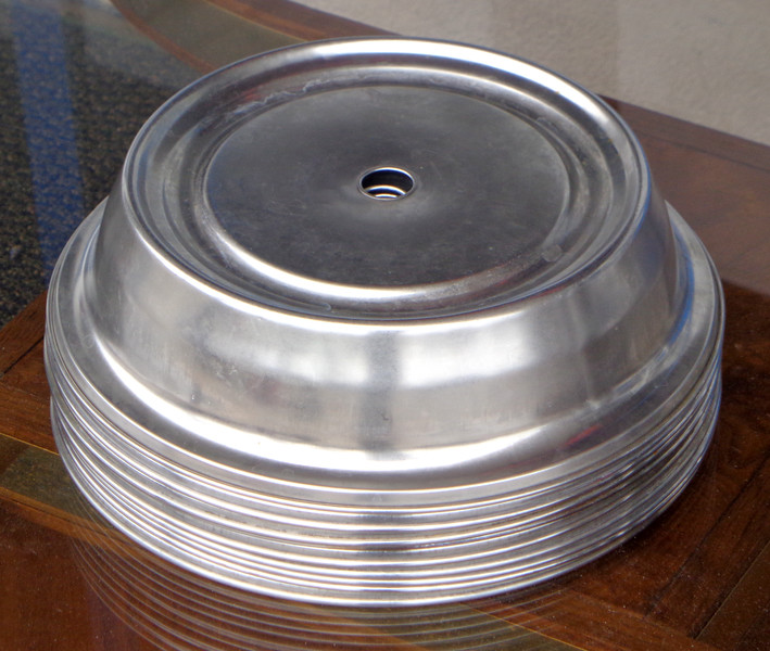 """Selection of used Stainless Steel Plate Warmers.  Whether you manage a hotel or hospital cafeteria, you are reliant on your plate covers to store dishes during transportation while keeping meals hot.  These ensure that the job is done in the most rugged and efficient way possible with this 10-15/16"""" - 11"""" Plate Cover.. It is made from satin finish stainless steel and has a finger hole for convenient removal. It is suited to plate diameters of between 10 15/6 and 11 inches. It is rust resistant and keeps its attractive look for many years."""