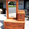 Unique Solid Wood Vintage Mirrored Dresser.  There's run-of-the-mill furniture and then there's quality vintage furniture.  This beautiful dresser hearkens back to days gone by with its unique styling and craftsmanship.  The overall look is charming and the piece is in structurally excellent condition.  Vintage buyers often prefer the weathered look of older furniture, but a few minutes with a bottle of Old English for Oak Wood will quickly take the years off and result in a lustrous patina.  42 x 19 x 73.  <b>$295</b>