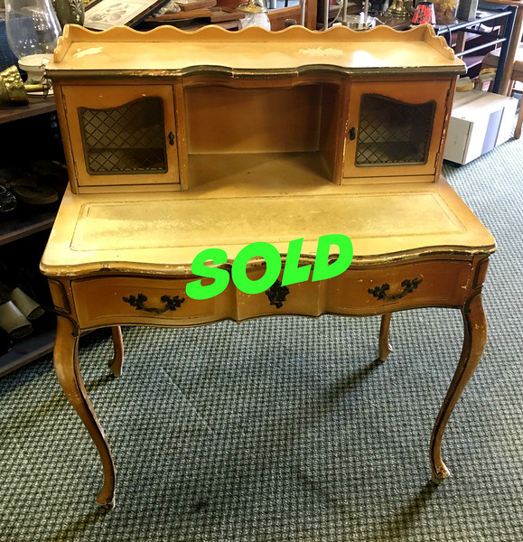 <b>Available at our Livernois Store Location - (313) 345-0884. </b>   Antique <i>Hammary</i> Queen Anne Secretary Writing Desk w/ Leather Top Inlay.  Quaint and Elegant French Provincial Writing Desk.  •Absolutely charming French inspired writing desk by reputable Hammary Furniture. •Rare and hard to find antique piece and very elegant.  •Features cabriole legs, metal mesh cabinets , multiple storage areas, and ample writing/work space.  36 1/2 x 22 1/2 x 41 3/4.  <b>$395</b>