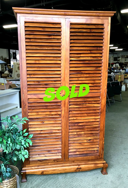 <b>Available at our Livernois Store Location - (313) 345-0884. </b>  Unique Louver Solid Wood Wardrobe Armoire. . Here's a distinctive wardrobe armoire that sets a sophisticated tone and reminds one warm sunshine and tropical breezes.  Upper section features shelved storage and the lover section includes 2 interior pull-out drawers.  Excellent condition.  50 x 28 x 90.  <b>$365</b>
