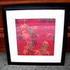 Colorful Contemporary Asian-Influenced Wall Hanging in Black Frame. On background of cinnabar red, traditional color for good luck in Japan.  With accents of multi-color bamboo foliage.  22 x 22.  <b>$25</b>