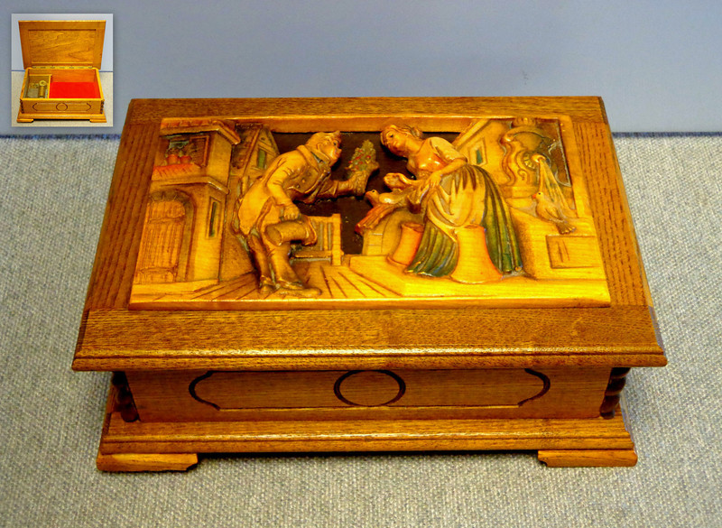 Beautiful Vintage Solid Oak  Reuge Music Box ~ Courting Couple.   Music box appears to have been over wound and does not play.  Tag on bottom states that the music box plays the song <i>Forever and Ever. </i>  9 1/2 x 7 x 4 1/4.   <i>Identical model recently sold on eBay for $275.  </i>  <b>Fred's Price: $125</b>