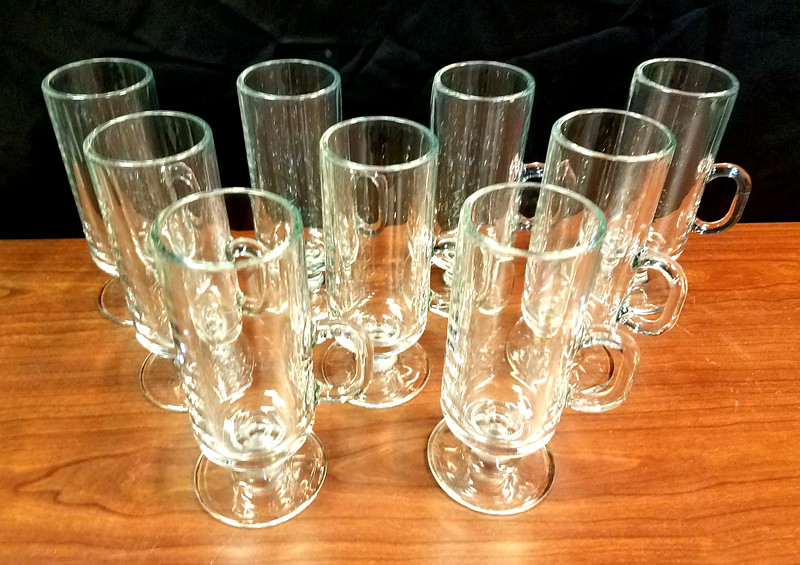 "Good Selection of <i>Libbey 5293 </i>- 8-1/2 Oz. Irish Coffee Glass Mugs.  These versatile glass mugs have a variety of uses, from serving Irish coffee, espresso drinks, ice cream creations, and teas. The mugs hold up to 8-1/2 ounces, and have an overall size of 6-3/8"" high by 3-5/8"" diameter (including the handle). It has a tall and slim design with a fluted pedestal base to provide stability on the tabletop.  We have a good inventory of these premium brandy snifters at the moment, so this is a good time for large quantity buyers to stop by.  <b>$3 each</b>"
