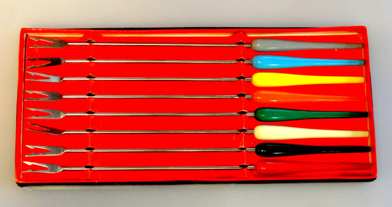 """Vintage 60's Colorful Handle Fondue Forks ~ Set of 8.  A complete set of 8 colorful handle fondue forks. Each tapered handle is made of hard plastic. Stainless steel tips. Made in Japan. Excellent, gently used condition. Original box.  Each fork 10.5""""L.  <b>$20</b>"""
