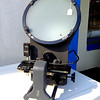 <i>Greenslade & Company</i> Optical Comparator.  Some critical fastener characteristics must be inspected using the Optical Comparator. These features include under head fillets, thread root radii, flat head and point angles. Additionally, Optical Comparators are very useful in measuring special features such as groove depths & widths, shoulder lengths, distance for first full thread to the head and chamfer diameters. The Optical Comparator is probably the most versatile instrument available for fastener measuring. <i>Units like these frequently sell for nearly $5,800 in similar condition.  </i>  <b>Make A Fair Offer.</b>