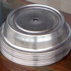 "Selection of Stainless Steel Plate Warmers.  Whether you manage a hotel or hospital cafeteria, you are reliant on your plate covers to store dishes during transportation while keeping meals hot.  These ensure that the job is done in the most rugged and efficient way possible with this 10-15/16"" - 11"" Plate Cover.. It is made from satin finish stainless steel and has a finger hole for convenient removal. It is suited to plate diameters of between 10 15/6 and 11 inches. It is rust resistant and keeps its attractive look for many years."