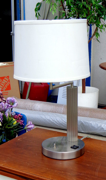 Nice Selection of Uniquely Styled Contemporary Stainless Steel Table Lamps / Table Lamp. Even features one AC power outlet making them extra convenient for cell phone and tablet computer charging.  12 x 22.  <b>$35 each.  </b>