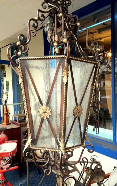 Ornately Accented Wrought Iron and Glass Hanging Chandelier.  <b>$85</b>