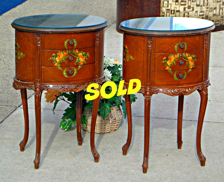 Set of 2 Hand-Painted Victorian End Tables with Glass Tops.  This delicately styled set of 2 Edwardian styled end tables set a classic tone in any fine home.  Each piece features distinctive accents and a custom fit glass top.   There are some signs of wear around the upper edges, but the right buyer will still be getting a tremendous value at Fred's low price.   21 x 15 1/2 x 29 1/2.  <b>$225 for the set.</b>