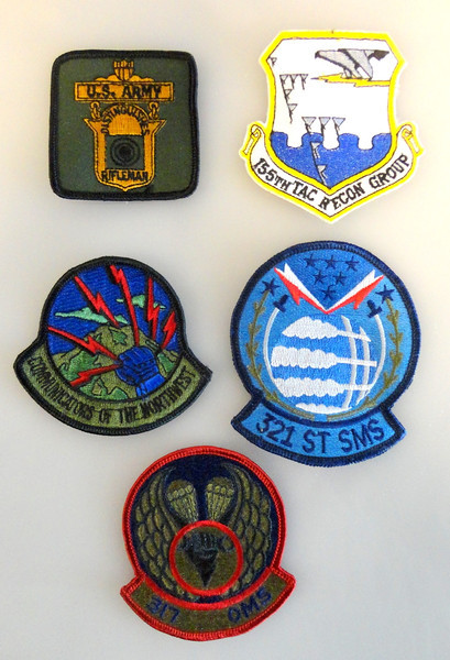 Assortment of Authentic Military Jacket Emblems.