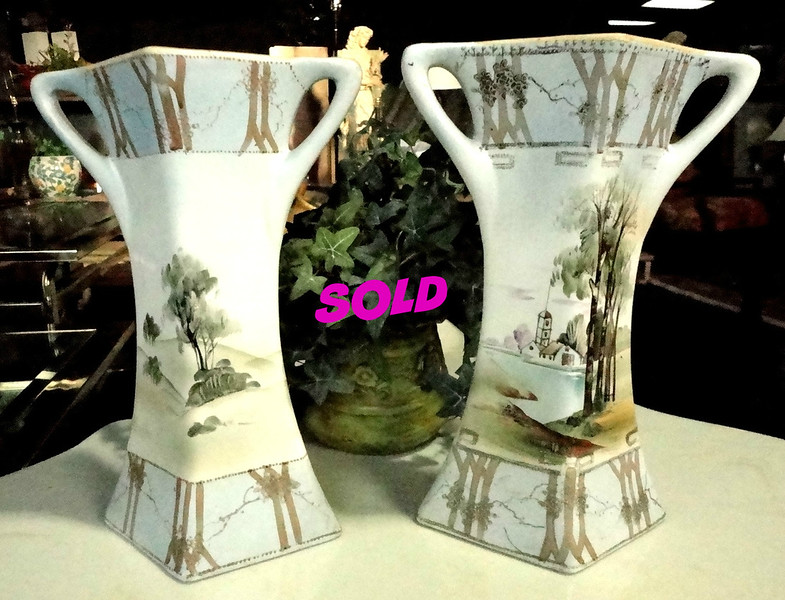 Set of 2 Authentic Royal Nippon Nishiki Vases in Excellent Condition. The artwork and style of Nishiki is known far and wide for quality and has become a noteworthy collectible.  These two authentic Nishiki vases are in excellent condition and both feature Asian scenic landscape.  Each vase measures 9 x 5 x 13.  These vases will add unique styling to your home.    <b>.</b>