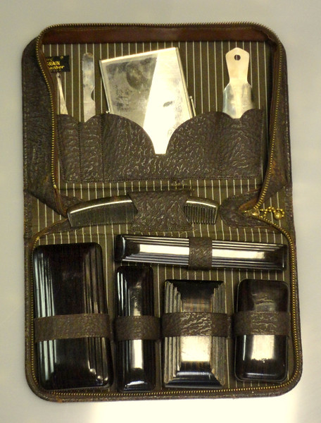 Vintage Men's Grooming Kit with Genuine Leather Carry Case.  Get your Brylcreem and Vitalis ready.........  You won't find many of these sets around anymore, especially in this good condition.  <b>$75</b>