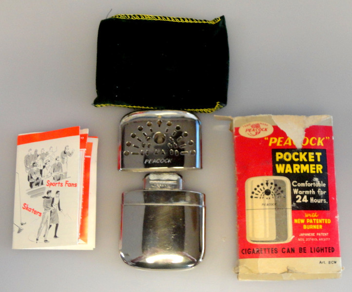 Vintage Never Used Peacock Pocket Warmer with Instructions. This warmer comes with paperwork and green pouch.   It measures 4 x 2 3/4 and has an approximate weight of 57.1g. A great way to keep warm when enjoying outdoor activities.  <b>$45</b>