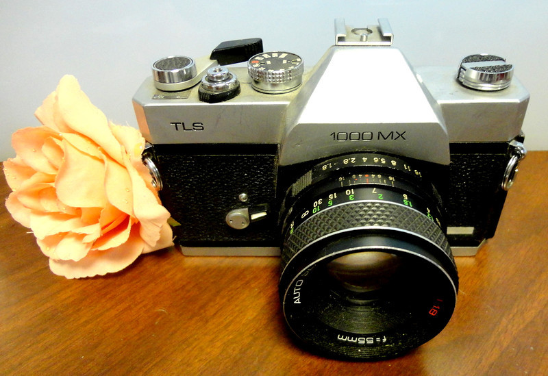 Vintage Sears TLS 1000 MX 35mm Camera.  TTL spot metering, measuring a rectangular area shown bracketed at the bottom of the viewfinder image, with a needle visible in the viewfinder. The MSX 1000 offers a self-timer, not found on the MSX 500. The flash sync speed is 1/60 sec.  These models use Mamiya SX lenses, an elaboration of the 42mm screw mount adding an aperture coupling pin for open-aperture metering. <b>$50</b>