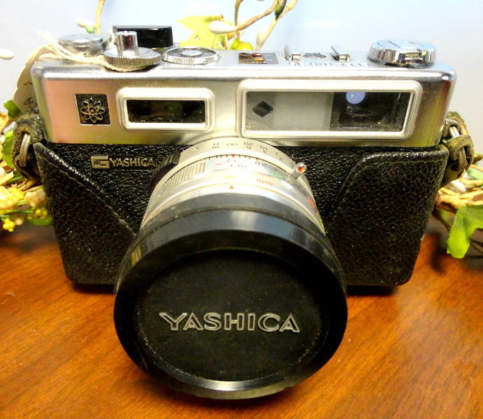 Vintage Yashica Electro 35 Camera.  The Yashica Electro 35 was one of the most popular 35mm camera of the 1960's and 1970's. Cherished for its solid construction, clear viewfinder, and super quiet operation, these cameras were a prized possession. Since the viewfinder is separated from the lens, these cameras are especially great for black and white, infrared, or any other photography types requiring a darker filter.  <b>$65</b>